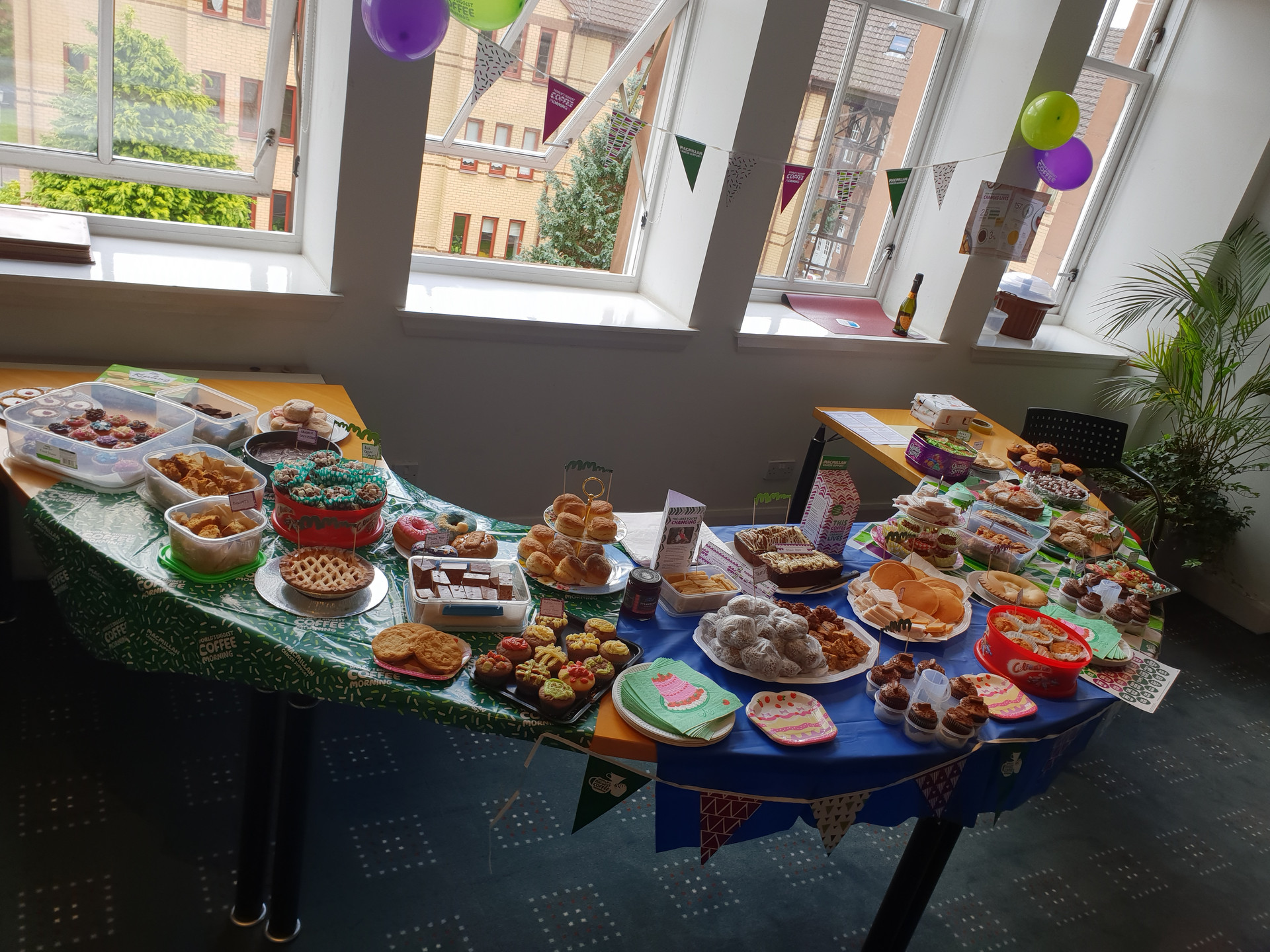 McMillian Coffee Morning Hosted by CRGP, showing the assortment of home baked goods the team brought to raise money for charity