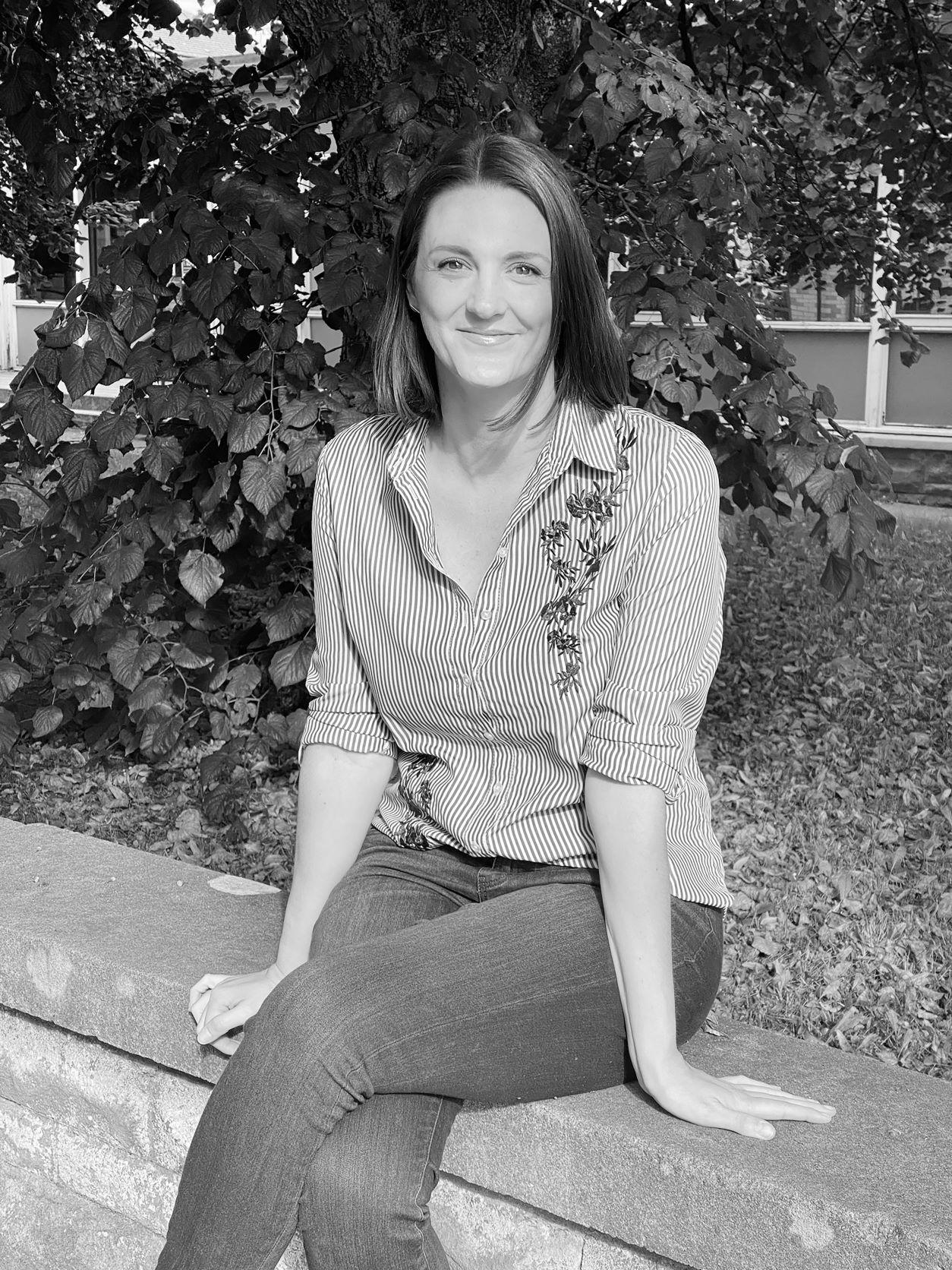 Image of Karen Wyatt sitting on a wall